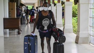 Angelo Mathews hauls his luggage upon arrival