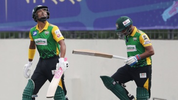 Najmul Hossain Shanto and Anisul Islam Emon walk out to bat