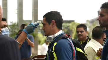 Quinton de Kock has his temperature taken as part of Covid-19 prevention measures in India earlier this year