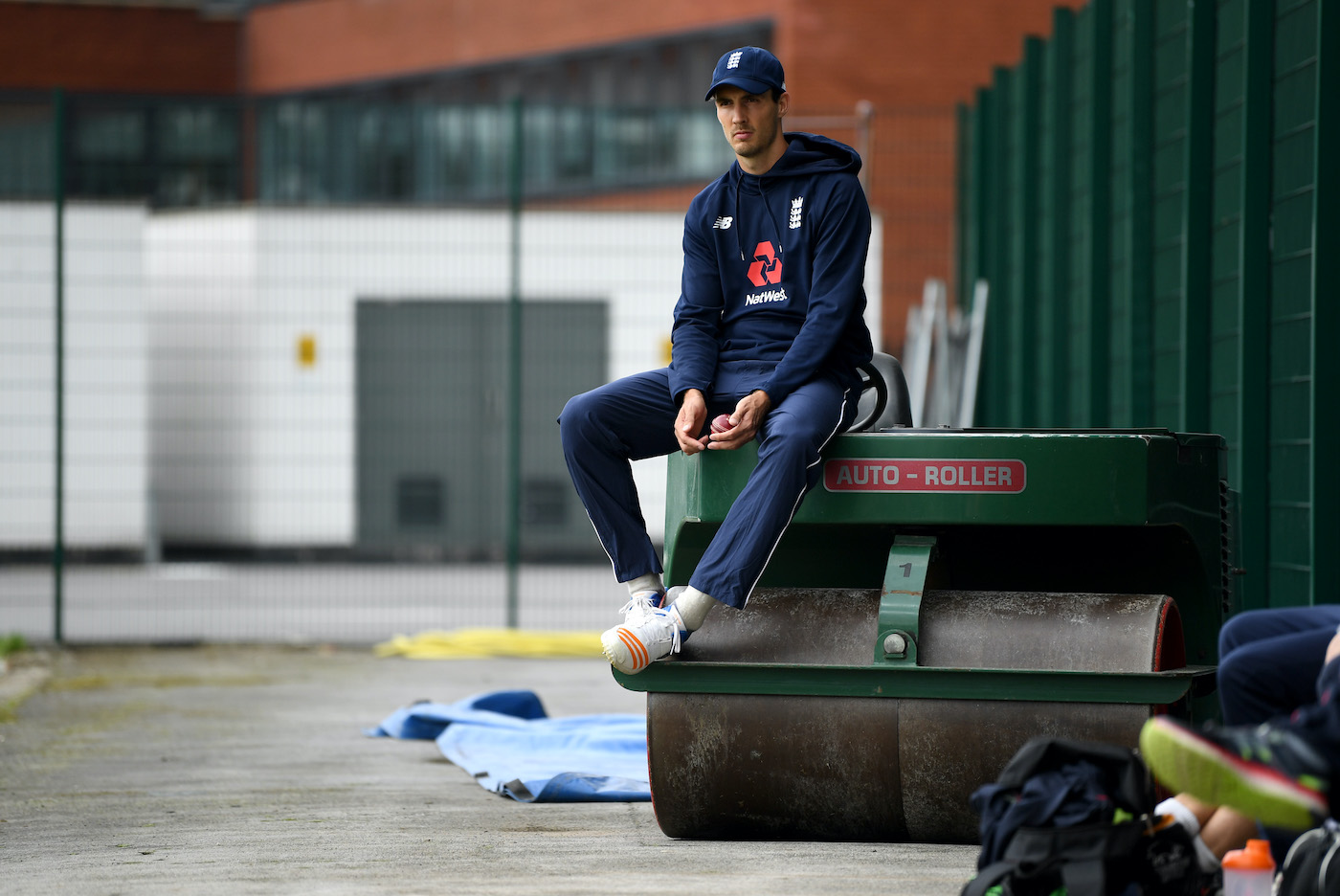 Steven Finn sits on a roller during a nets session before the South Africa series