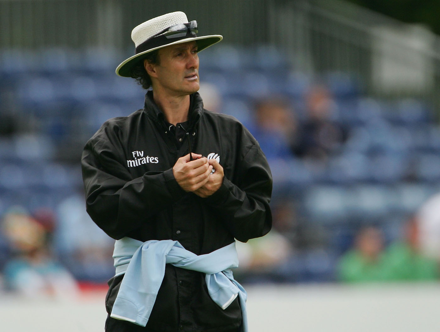 Billy Bowden cuts a sharp figure in all black, boater and sunnies