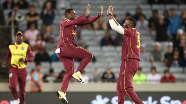 Fabian Allen and Kieron Pollard celebrate after Ross Taylor was run out