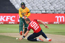 Tom Curran stoops in his followthrough as Heinrich Klaasen drives back down the ground, South Africa v England, 1st T20I, Cape Town, November 27, 2020