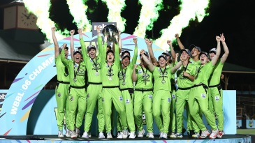 The Sydney Thunder players celebrate with the trophy