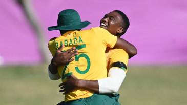 Kagiso Rabada and Lungi Ngidi celebrate a breakthrough for South Africa