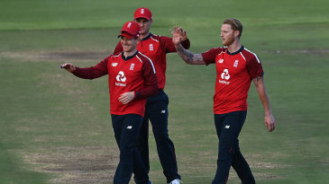 Eoin Morgan, Ben Stokes and Jason Roy celebrate another England wicket