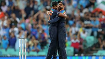 T Natarajan celebrates a wicket with his captain Virat Kohli
