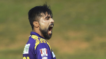 Mohammad Amir exults during his five-for