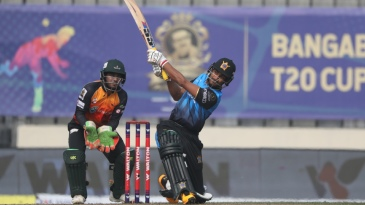 Mohammad Naim hits one of his four sixes off Shakib Al Hasan