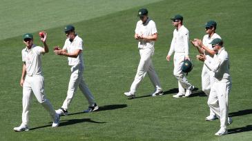 Josh Hazlewood leads Australia off after registering figures of 5-3-8-5