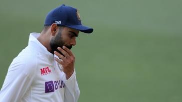 Virat Kohli walks off the field after India's eight-wicket loss