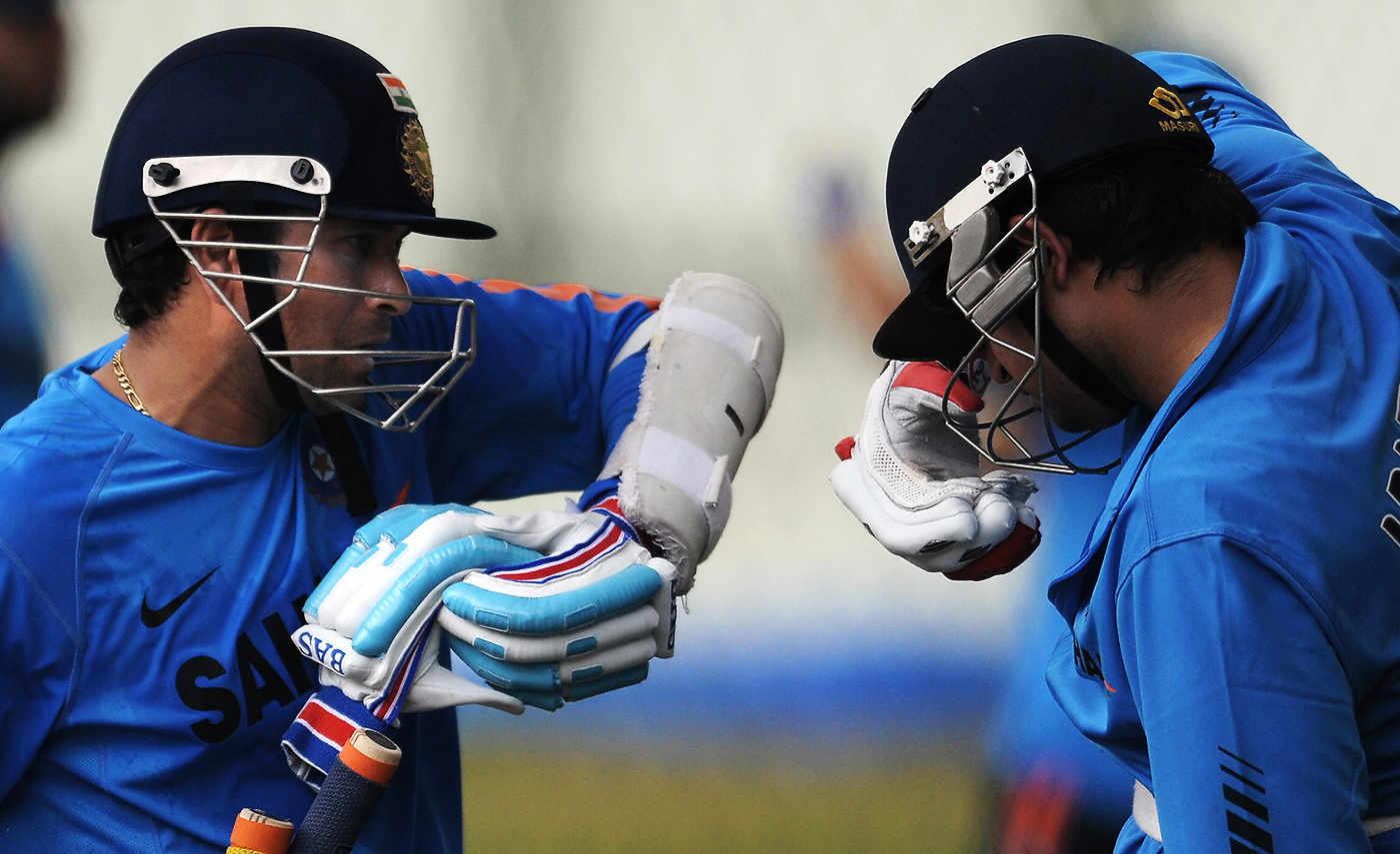 Sachin Tendulkar and Suresh Raina at training