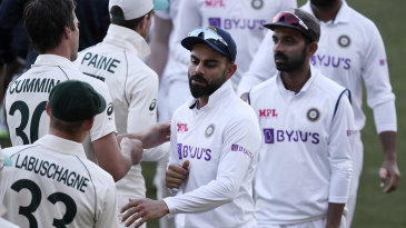 The Indian players greet Australia's players at the end of the game