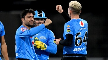 Rashid Khan celebrates after taking a wicket