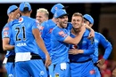 Danny Briggs is congratulated by his team-mates, Brisbane Heat vs Adelaide Strikers, BBL 2020, Brisbane, December 23, 2020