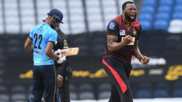 Kieron Pollard roars after taking a wicket