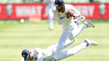 Ravindra Jadeja hangs on to a catch after nearly colliding with Shubman Gill