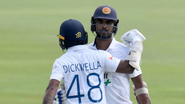 Dinesh Chandimal is congratulated by Niroshan Dickwella for his half-century