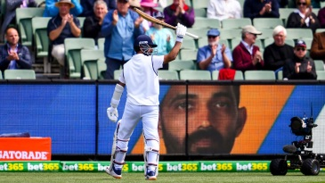 Ajinkya Rahane walks back to the applause