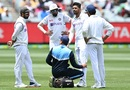 The physio inspects Umesh Yadav's calf, Australia vs India, 2nd Test, Melbourne, 3rd day, December 28, 2020
