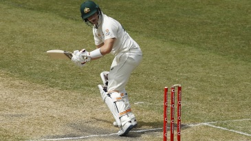 Steven Smith is bowled as the ball just dislodges the leg bail