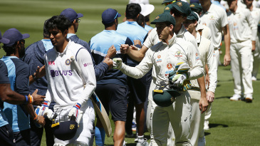 India and Australia players fist-bump each other at the end of the match
