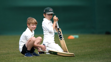Young cricketers look on during a junior training session at The Wimbledon Cricket Club