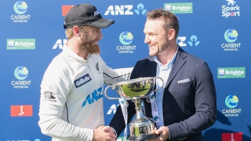 Kane Williamson receives the trophy from his predecessor, Brendon McCullum