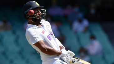 Cheteshwar Pujara drops his hands and sways out of the way of a snorter