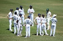 The Indian players gather around Mohammed Siraj and Ajinkya Rahane as abusive spectators in the stands are dealt with, Australia vs India, 3rd Test, Sydney, 4th day, January 10, 2021