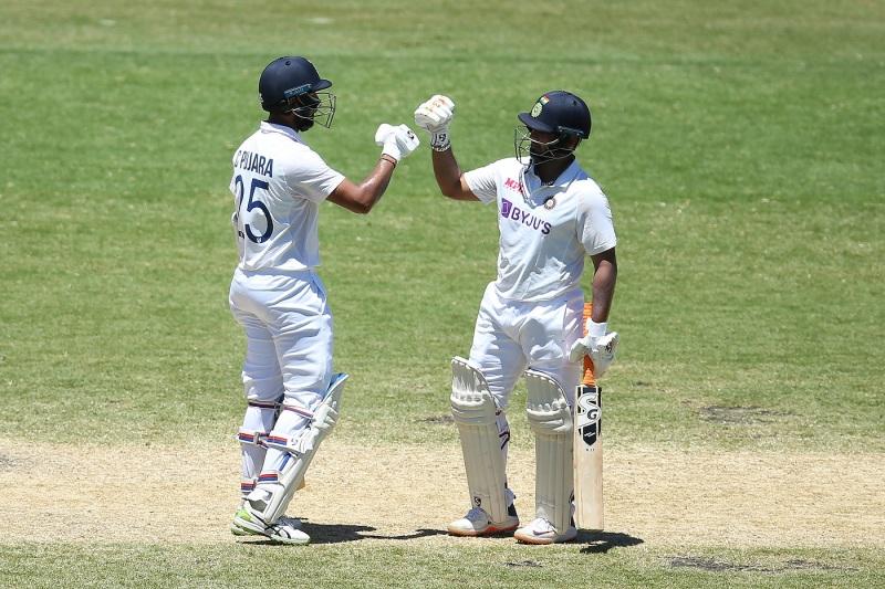 Cheteshwar Pujara and Rishabh Pant bump fists during their partnership