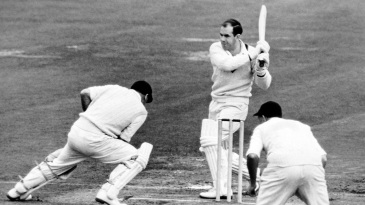 Colin McDonald swings Tony Lock away for a boundary