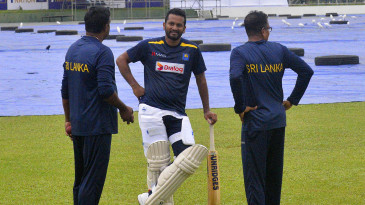 Dimuth Karunaratne in discussions with team staff ahead of the first Test against England
