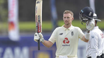 Joe Root raises the bat after passing 150
