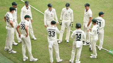 Tim Paine addresses Australia's huddle before the start of day five