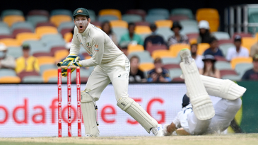 Cheteshwar Pujara scrambles for safety as Tim Paine collects a throw