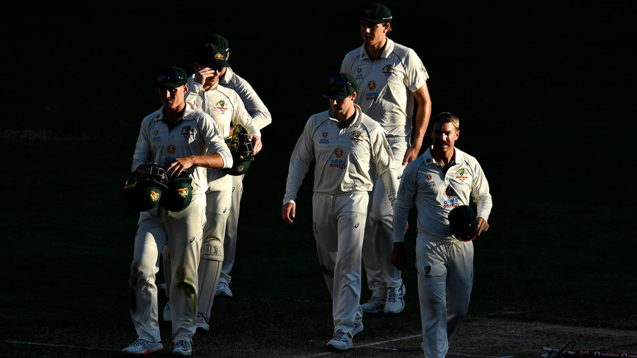 The Australians leave the field