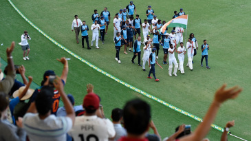 India's players take a victory lap around the ground