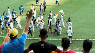 Fans greet the Indian players on their victory lap around the Gabba