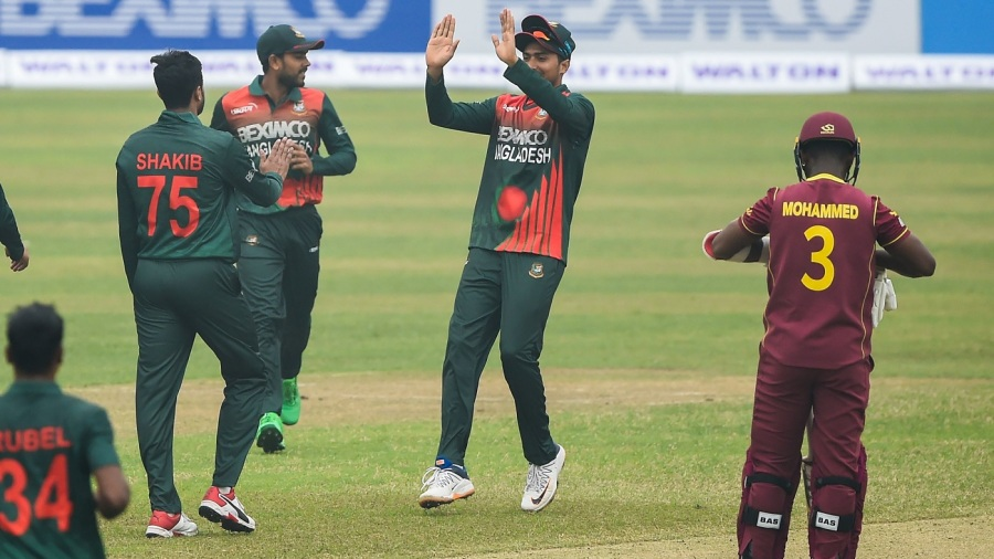 Shakib Al Hasan is congratulated for a wicket