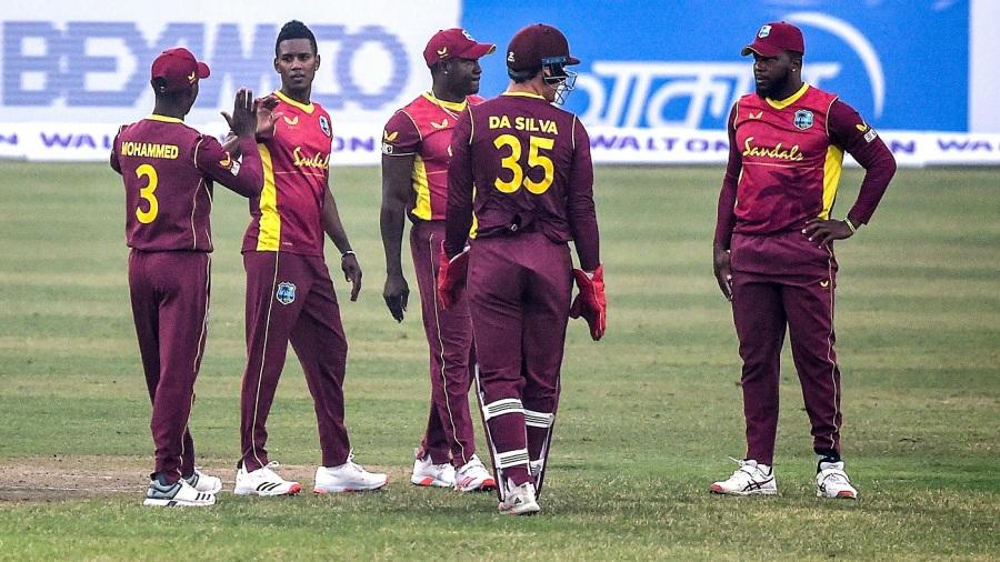 Akeal Hosein celebrates with team-mates after dismissing Liton Das