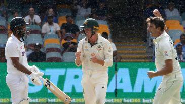 Pat Cummins celebrates Cheteshwar Pujara's wicket
