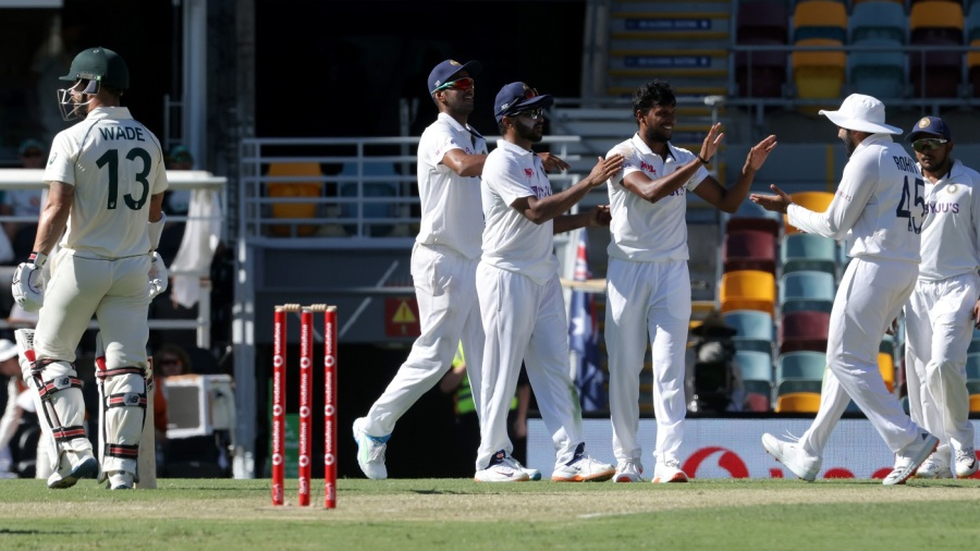 T Natarajan celebrates with team-mates after dismissing Matthew Wade
