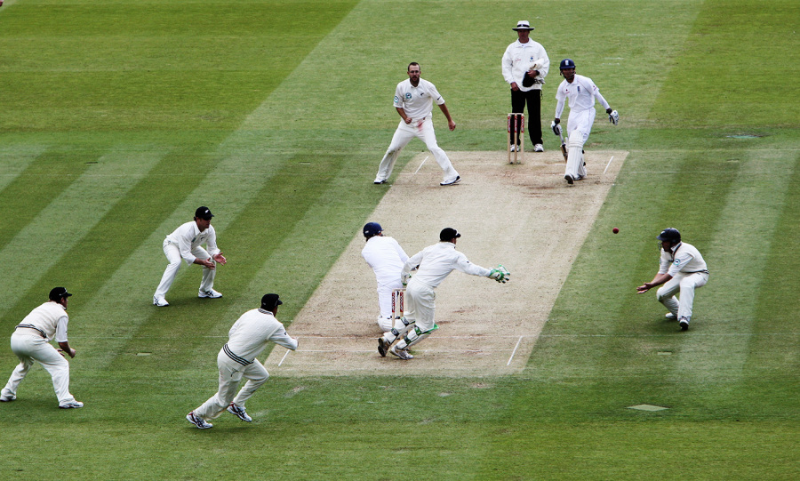 Stuart Broad turns the ball to leg side, watched by Daniel Vettori and New Zealand's fielders