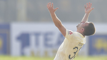 Mark Wood celebrates his first wicket of the series