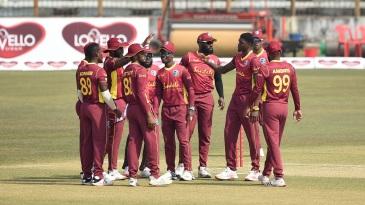 Alzarri Joseph celebrates the dismissal of Liton Das with his team-mates
