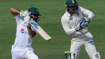 Quinton de Kock looks on as Fawad Alam punches through cover