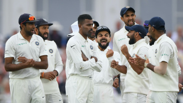 Virat Kohli and his team-mates react after Joe Root is given out