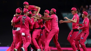 The Sydney Sixers players celebrate after clinching victory in the BBL 2020-21 final
