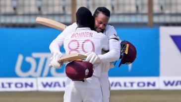 Centurion Kyle Mayers gets a hug from Nkrumah Bonner after reaching his maiden international ton
